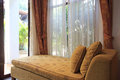 Cosy sofa by the window in house Royalty Free Stock Photography