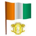 Cote divoire wavy flag and coat of arms against white background vector art illustration image contains transparency Royalty Free Stock Image