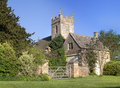 Cotswold church and cottage Royalty Free Stock Photo
