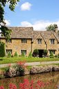 Cotswold cottages lower slaughter alongside the river eye cotswolds gloucestershire england uk western europe Royalty Free Stock Images