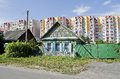 Cottage on the background of high rise buildings merger village and town gomel belarus Royalty Free Stock Images