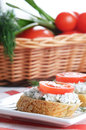 Cottage cheese bruschettas and vegetable basket sandwiches with tomato dill on the kitchen table Stock Images