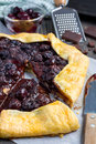 Cottage cheese dough galette with cherries and chocolate, vertical Royalty Free Stock Photo