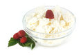 Cottage cheese in a glass bowl and raspberries Royalty Free Stock Photo
