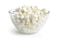 Cottage cheese in glass bowl on a white background Royalty Free Stock Images