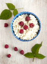 Cottage cheese with raspberrys top view on the blue plate Stock Image