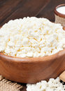 Cottage cheese in rustic wooden bowl Stock Photo