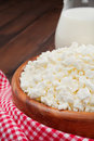 Cottage cheese in rustic wooden plate Royalty Free Stock Photos