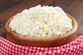 Cottage cheese in rustic wooden plate Stock Photo