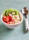 Cottage cheese with strawberries, kiwi, honey, cereals and seeds of flax - a healthy food, tasty and healthy Breakfast or snack. Royalty Free Stock Photo