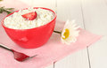 Cottage cheese with strawberry in red bowl Stock Image