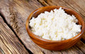 Cottage cheese on wooden board Royalty Free Stock Images