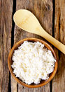 Cottage cheese on wooden board Stock Photos