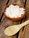 Cottage cheese on wooden board Stock Image