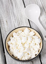 Cottage cheese on wooden board dairy products a background Stock Images