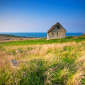 Cottage by the sea Stock Images