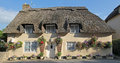 Cottage with straw thatched roof, bed and breakfast house Royalty Free Stock Photo