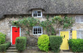 Cottage with straw thatched roof and  colorful doors Royalty Free Stock Photo