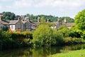 Cottages alongside river bakewell the wye derbyshire england uk western europe Royalty Free Stock Photo