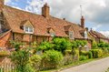 Cottages of turville buckinghamshire england gardens in front row in the village with blue skies Stock Images