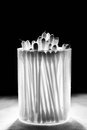 Cotton bud on black background Royalty Free Stock Image