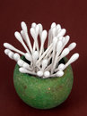 Cotton buds, swabs in rustic pot Stock Photos