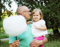 Cotton candy man holds his daughter and Royalty Free Stock Photos