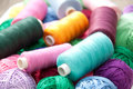 Cotton yarn bobbins of different colours Stock Photos