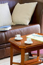 Couch and coffee table the on the are cups notebook Royalty Free Stock Photography