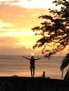 sunset with the caraibean sea and a shadow up arms Royalty Free Stock Photo