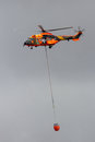 Cougar helicopter bambi bucket Royalty Free Stock Photo