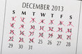 Count down to christmas date close up of calendar page with some of the days crossed off with a red x Stock Image