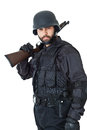 Count on me a swat agent wearing a bulletproof vest and aiming with a gun Royalty Free Stock Photo