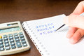 Count and write the result calculation with a calculator to right in notebook Royalty Free Stock Photography