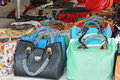 Counterfeit bags rome italy – june big pile of colorful handbags of famous fashion brands sold on porta portese flea market in Stock Photo