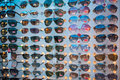 Counterfeit goods of RayBan sunglasses in black market Royalty Free Stock Photo