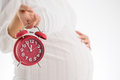 Counting hours expecting child birth. Motherhood concept. Pregna Royalty Free Stock Photo