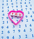 Counting on you text in red uppercase letters small white cubes surrounded by a heart shape and placed upon a sheet with an array Royalty Free Stock Photo