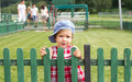 Country baby girl near a wooden fence Stock Images