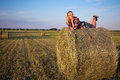Country concept beautiful romantic woman lying on haystack in young field Royalty Free Stock Photography