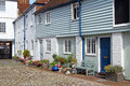 Country cottage mews and flowers photo of weather boarded kent with potted plant gardens Royalty Free Stock Photography