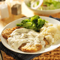 Country fried steak with side dishes southern style peppered milk gravy Stock Photography