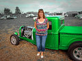 Country gal vintage customised truck photo of a standing next to a ford pickup showing at the whitstable car show on st Royalty Free Stock Photography