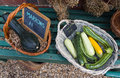 Country garden home grown vegetables for sale baskets of organic courgettes and marrows in an english Royalty Free Stock Photo