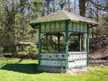 Country gazebo a rustic green and white used as a yard landscape feature Royalty Free Stock Photos