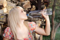 Country girl drinking water beautiful Stock Images