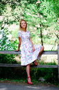 Country girl full length portrait of a young woman in a vintage dress and shoes Royalty Free Stock Photo