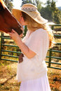 Country Girl Gives Horse A Kiss Stock Image