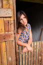 Country girl imagining better future in a old barn imagines life crossed arms weakness Royalty Free Stock Photos
