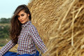 Country girl sitting at haystack Stock Images
